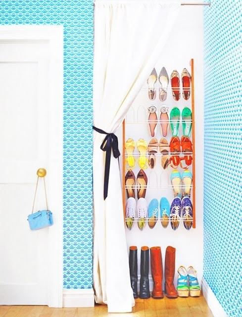 Cover a shoe rack with a curtain.