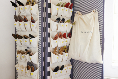 Hang shoe organizers on a room divider or screen.