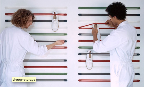 elastic shoe straps are a quirky and colorful way to hang your shoes on the wall