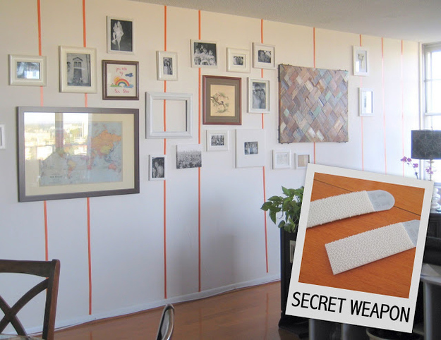 Use velcro strips to hang framed photos.