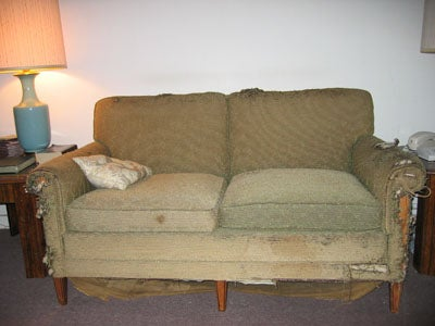 """You've got a couch that's super ugly but super comfortable and you can't bear to part with it, or simply can't afford a new couch. There are simple things you can do to distract from a couch that's the color of saag paneer, or puked-up saag paneer. Each time a guest comes over, if he or she starts to look at your couch, just yell """"Hey! Look over here!"""" to divert attention away from the couch. Drop a glass or bang on some pots and pans. Just create any kind of distraction so that no one notices your hideous couch."""