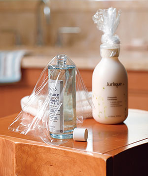 Cover the openings of your toiletries with saran wrap, then put the tops back on.