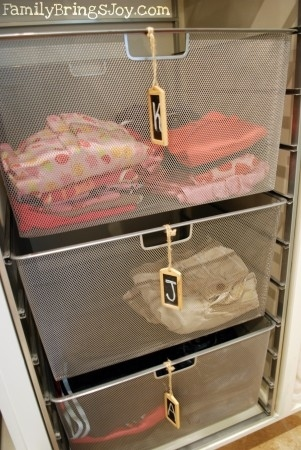 install labeled baskets for family members to pick up their laundry