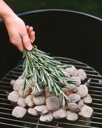 Once the coals are uniformly gray and ashy, cover them with fresh rosemary branches. Your meat and vegetables will be flavored with the taste of savory herbs.