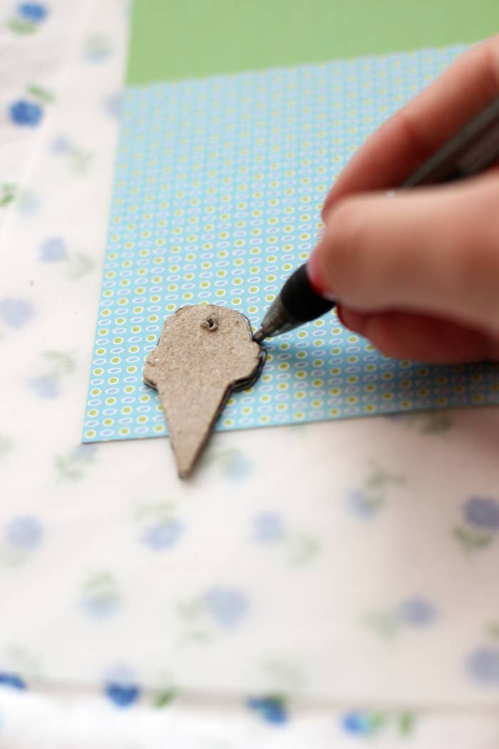 Layer the washi tape across the cut-out. The pendant shown used four pieces for optimum color.