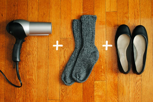 Step 1: Put on thick socks, and then your flats.Step 2: Blow-dry your shoes around the tight sections for a few minutes.Step 3: Keep your socks/flats on while it cools.Step 4: Test them out; repeat process if you need them more stretched out.