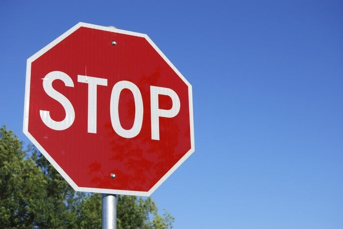 Texans be using street signs to direct automotive and pedestrian traffic!