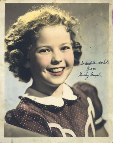 "Hand-colored studio portrait of Shirley Temple with handwritten inscription: ""To Andrew Worhola [sic] from Shirley Temple"", 1941 (The Andy Warhol Museum, Pittsburgh; Founding Collection, Contribution The Andy Warhol Foundation for the Visual Arts, Inc.)"