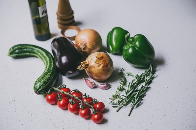 - 2 onions- 2 cloves garlic- 1 eggplant - 1 zucchini- 2 green peppers- 8 small tomatoes- 2 sprigs fresh rosemary- 3 sprigs fresh thyme- olive oil- salt, pepper- foil- an oven-proof baking dish, like this or this or anything similar.