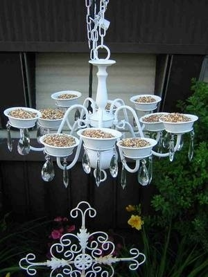 Repurpose an old chandelier as a bird feeder.
