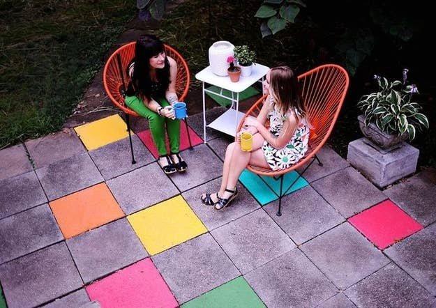 41 cheap and easy backyard diys you must do this summer use latex floor paint to color cement tiles on an outdoor patio solutioingenieria Images