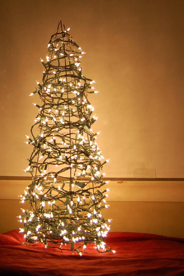 for the gardeners heres a christmas tree made from a tomato cage - 4 Christmas Tree