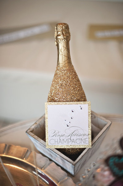 Cover your champagne bottles in glitter.