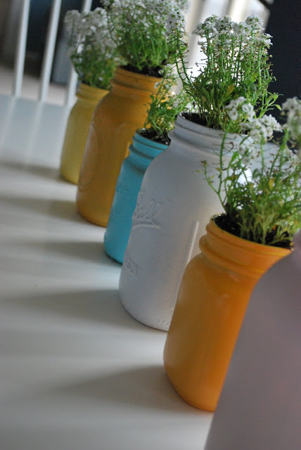 Mason jars can become all kinds of centerpieces, like these spray-painted ones: