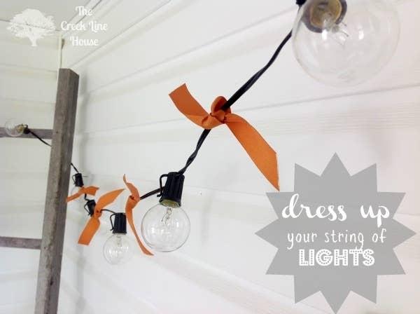 Tie ribbons between lights