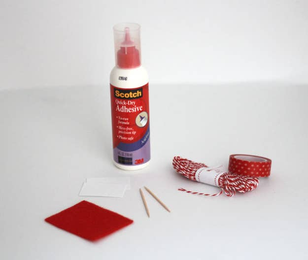 Measure out and cut two pieces of twine to fit diagonally across your piece of card stock. Then, glue the twine pieces in an X by placing a dot of glue onto each corner.