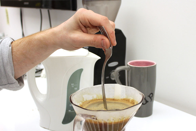 Stir the coffee three times to break up the crust that has formed.
