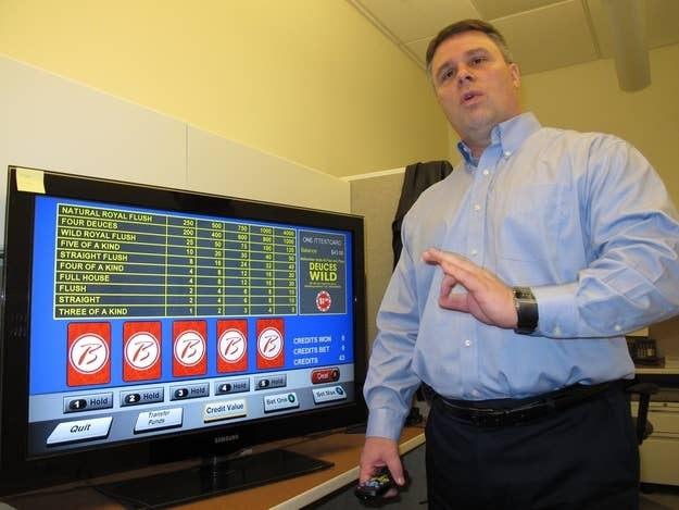 John Forelli, a vice presicent at the Borgata Hotel Casino & Spa in Atlantic City NJ demonstrates a new in-room gambling system Monday Feb. 11, 2013 in Atlantic City. The system will be available to guests starting Feb. 18. The casino says it is the first in the nation to offer this technology, which is says can be expanded to encompass hand-held gambling devices and even Internet betting once it is legalized.