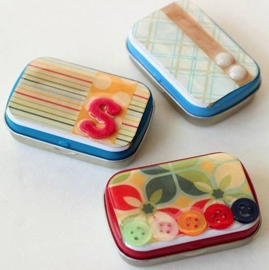 So there are dozens of things you can do with those little aluminum boxes, including decoupage. It's a cute way to store buttons, or disguise contraband. Directions here.