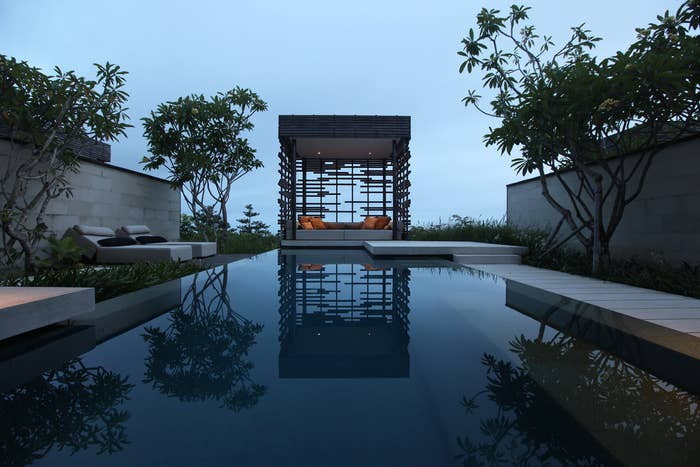 The Alila Villas Uluwatu resort includes a gorgeous infinity pool and an overhanging cliff-side platform with dramatic views over the Indian Ocean.