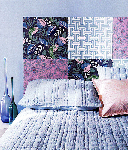 Use large sheets of scrapbook paper as a temporary headboard.