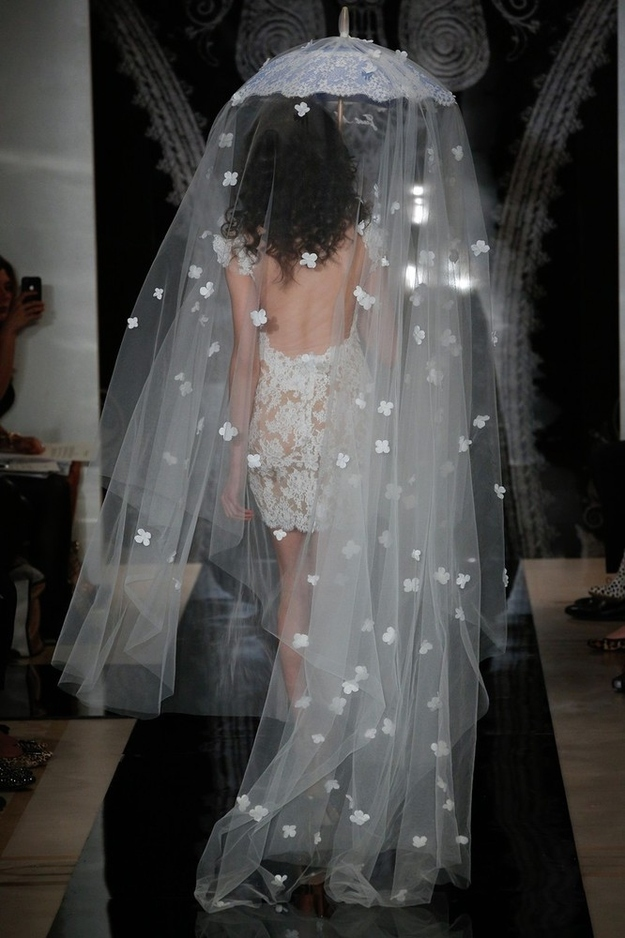 Make sure your parasol-veil has extra fabric in the back in case your dress happens to be see-through.