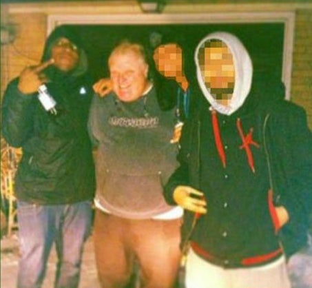 The man to Ford's right is Anthony Smith, recently killed in a gangland shoot-out.