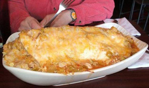 Where: Jack-N-Grill – Denver, Colo.Challenge: This 7-pound breakfast burrito is no joke, consisting of 7 potatoes, a pound of ham, a whole onion, cheese, chili, and, of course, a dozen eggs. There's only one rule: no bathroom breaks.Prize: Free food FOR LIFE is awarded to any woman who can finish this meal.