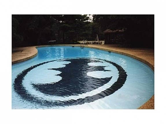 Holy pool, Batman! Usually the Bat signal is spotted in a dark sky over Gotham City, but in this Illinois home, the symbol is found underwater on the bottom of the pool.
