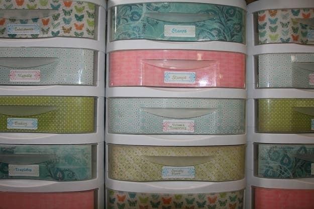 Line your standard plastic storage drawers with decorative paper. - 17 Super Simple Dorm Organization Tricks