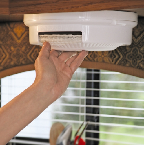 Get a ceiling-mounted paper plate dispenser.