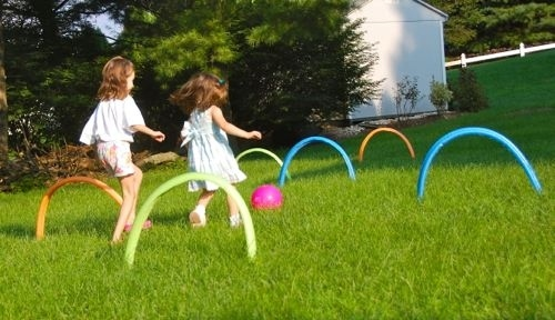 Set up pool noodles for a game of kickball croquet.