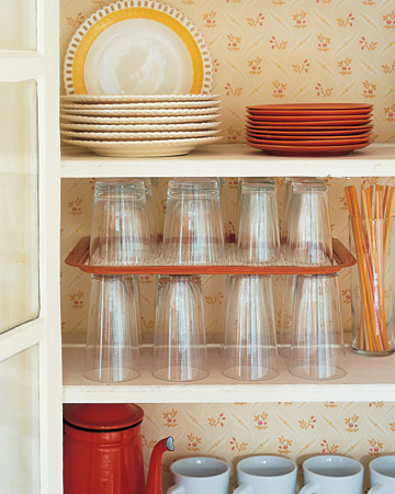 Maximize glassware storage space with this tray trick.