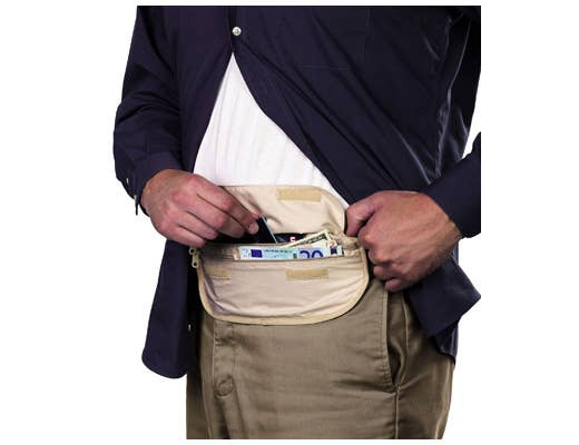 """Bring a money belt, or as I see it, the """"inside fanny pack"""" or """"fanny pack diaper."""" Here a guy wears it on the outside to show you how loaded he is, but in reality, this would be tucked into the front of his pants. This is a common (also paranoid) tourist practice in Europe to avoid pickpockets."""