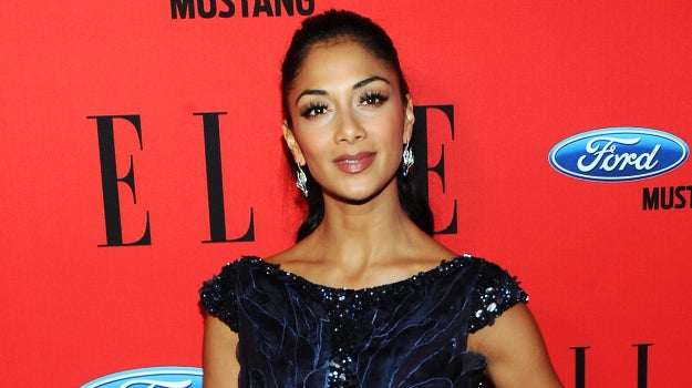 Nicole's dad was Filipino, but her parents split when she was a baby. She changed her surname from Valiente to Scherzinger when her stepfather adopted her.