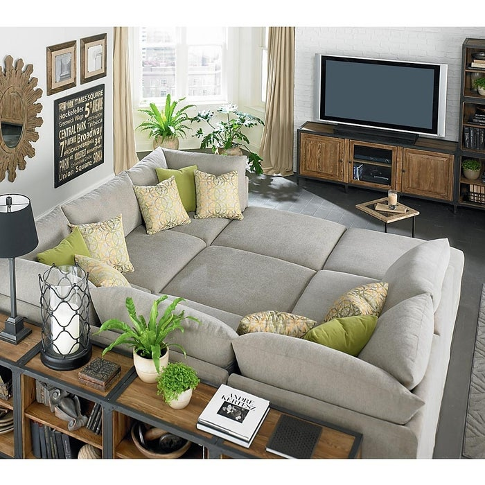 Get this sectional in a soothing slate gray for classy canoodles. Starting at $6,024, from Bassett Furniture.