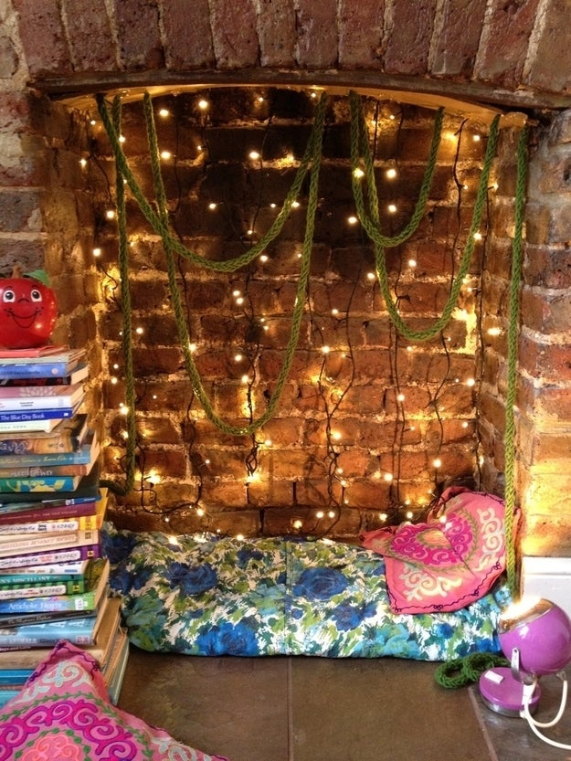 21 cozy makeshift reading nooks turn a fireplace into a nook with string lights and pillows solutioingenieria Image collections