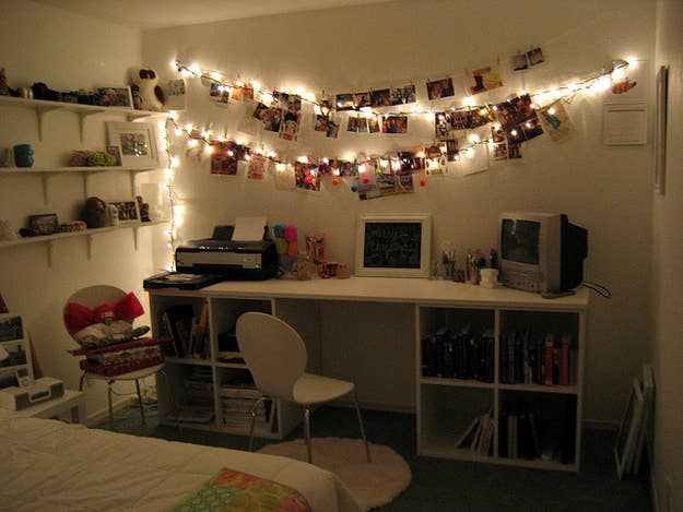 dorm lighting ideas. illuminate your photos by hanging them alongside twinkle lights dorm lighting ideas