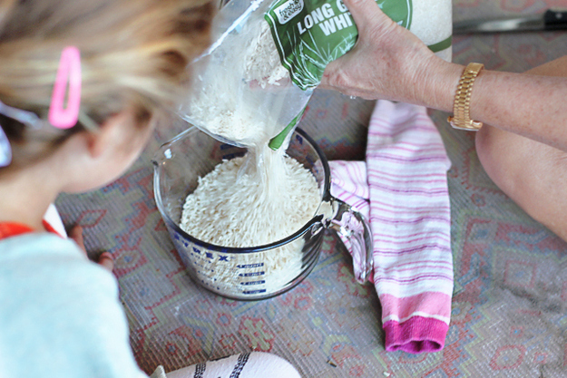 Use rice and a sock to make a DIY hot pack.