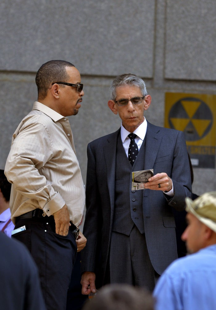 Ice-T speaking to Richard Belzer, who is holding a card with Trayvon Martin on the back.