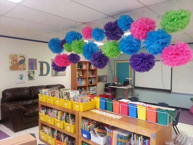 Make some easy Truffula flower pom-poms as ceiling decorations.