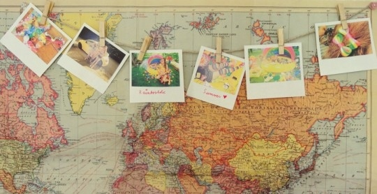 Turn your photos into faux polaroids and hang them on a small clothesline.