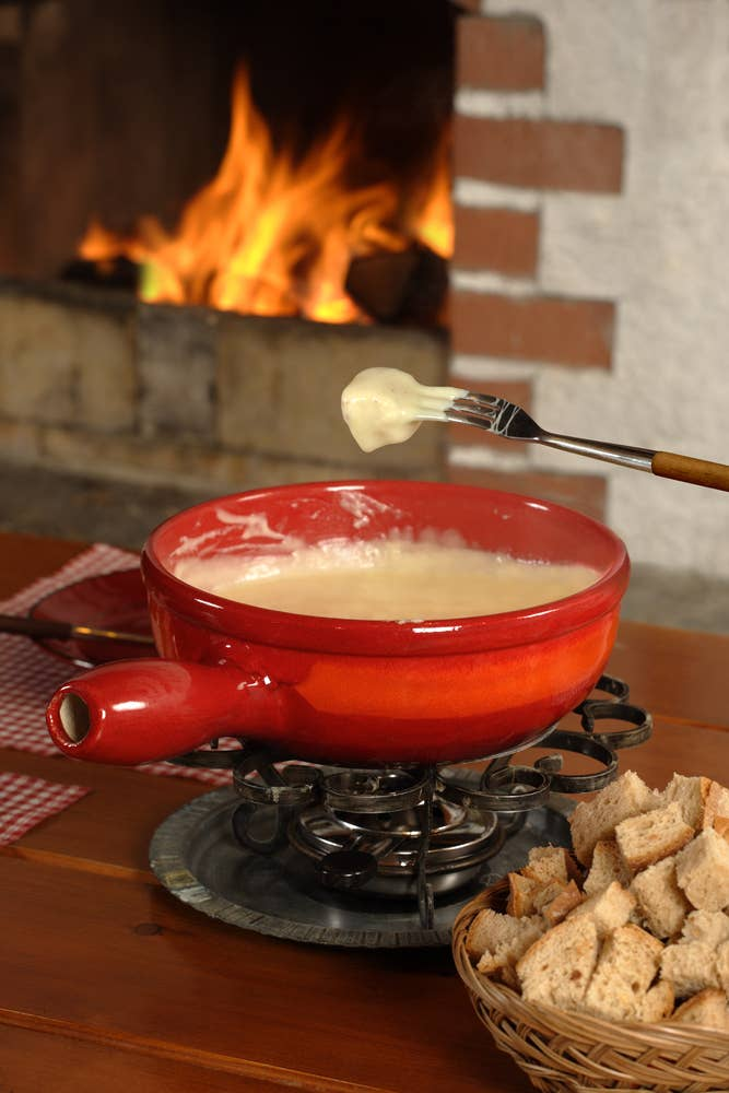Spread a blanket out in the living room. Make some s'mores on the stove and set up a nice fondue pot.