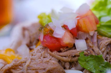 Kalua Pork or Kalua Pig is Hawaii's version of pulled pork cooked in an underground oven or imu, the smokey, succulent pork literally falls of the bones! This is another must-have at any luau and is as authentic as it gets when it comes to true Hawaiian-fare.. Fortunately for you, the recipe doesn't require you to dig a hole in the ground!Get Recipe
