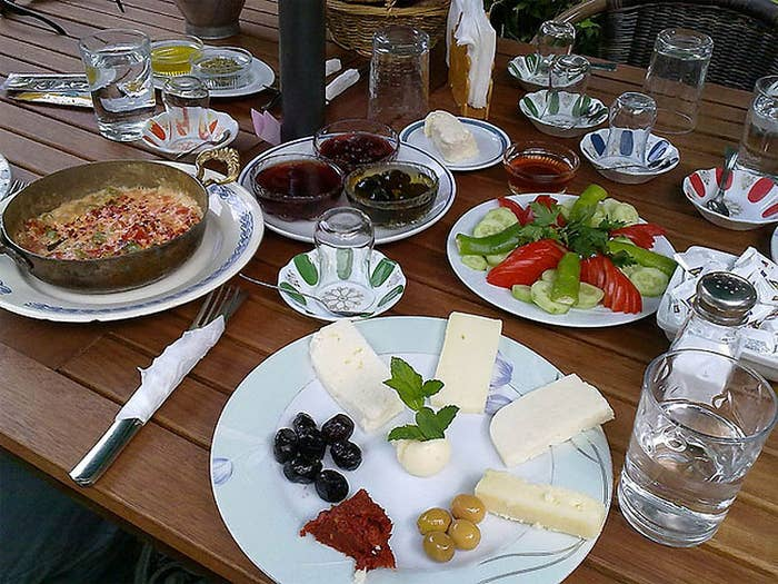 This popular Turkish breakfasts consists of lots of little bites of food: cheeses, butter, tomatoes, spiced meats, cucumbers, olives, and eggs.