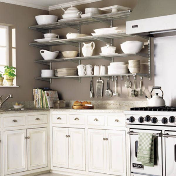 Have an empty wall without enough storage? Hang a couple of rows of shelves there instead. The Inspired Room shows you how to keep those shelves looking awesome.