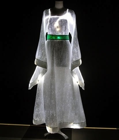 Made up of ultra-thin optical fibers woven together with other synthetic fibers, Luminous Fabric lights up the night when connected to battery-operated LEDs cleverly hidden from sight in specially made pockets. The lightweight material is versatile; changing the look of the outfit is as easy as changing the LED colors.