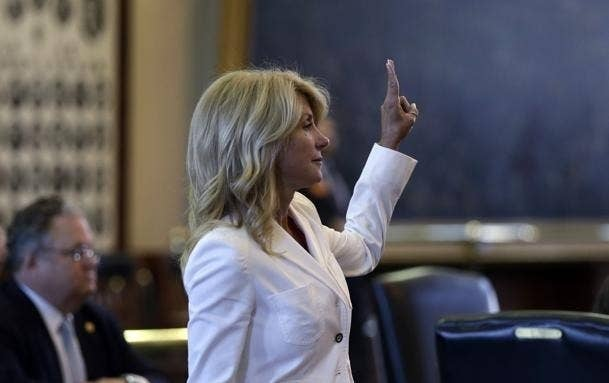 """This is Senator Wendy Davis. She's saying, """"Peace on Earth, and fuck you, Rick Perry."""""""