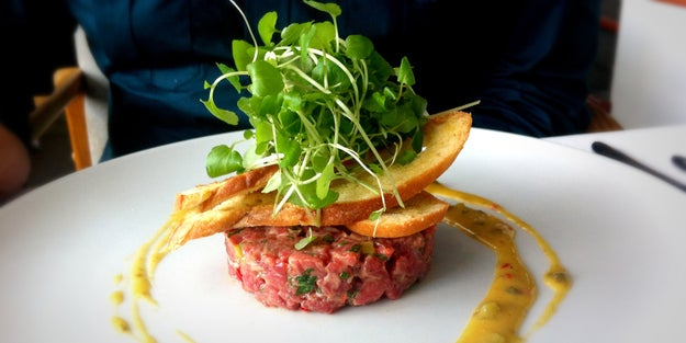 In the hands of a chef, steak tartare can be a truly beautiful thing. The process seems fairly straightforward: Obtain high quality beef, cut carefully into small pieces, season heavily, dress with a sauce or vinaigrette with balances flavors of salty and sour, then plate with the appropriate accoutrements (usually some kind of crunchy bread or potato product). When done right, it is cold and salty and gamey and has that perfectly tender texture that even the rarest cooked meat can never achieve.But, please understand: It is ACTUALLY VERY HARD TO MAKE. So, as much as you might enjoy ordering it at restaurants, please learn from the disgusting mistakes so many people have posted on the internet, and don't try this at home.