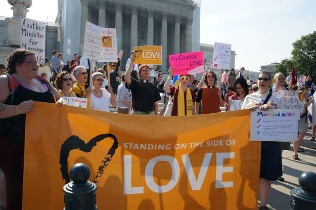 Demonstrators gather outside the U.S. Supreme Court on the day that the Court struck down the Defense of Marriage Act, Wednesday, June 26, 2013, in Washington, D.C.